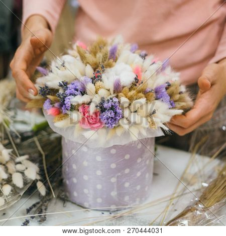 The Process Of Making A Bouquet. Colorful Bouquet Of Different Dried Flowers Deadwood Flowers In The
