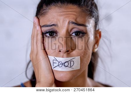 Close Up Face Of Sad Beautiful Woman With Taped Mouth Text No Food Written