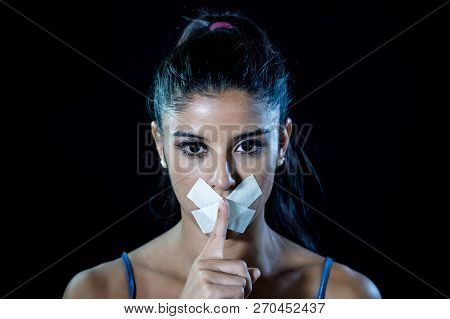 Attractive Young Woman Mouth Sealed On Adhesive Tape And Silence Gesture