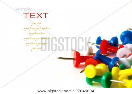 Group of colorful push pins on white background.