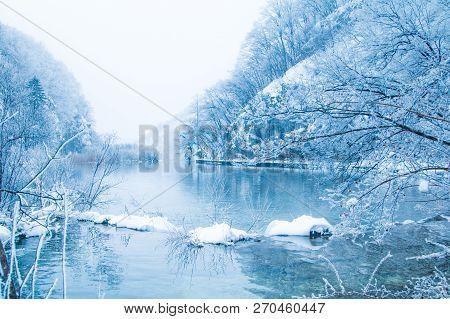 Croatia, Plitivice, Winter Landscape, Frozen Waterfalls And Lakes In Popular Nature Park Plitvicka J