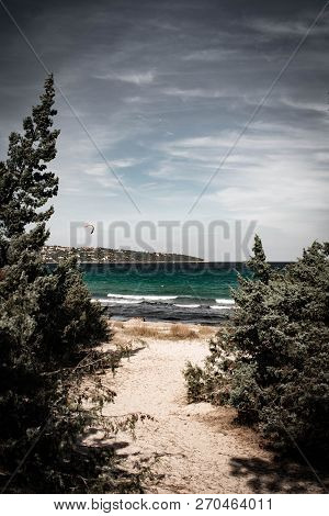 Dramatic Ocean Sea Shore With Contrast Clouds At The Beach With Moody Dramatic Ambient