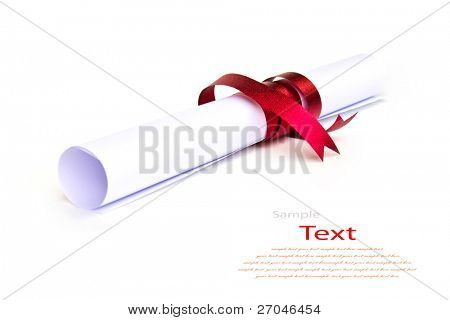 Diploma wrapped with a red ribbon on white background.