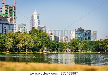 Bangkok, Thailand - November 2018: Sunny Day In Lumphini Park In Bangkok, Thailand, Skyscrapers In T