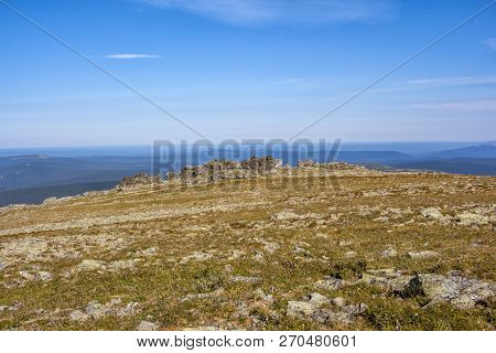 Unreal Beauty Sky In The Mountains Of The Tundra. Russia Northern Urals. Stones Are Folded In The Tr