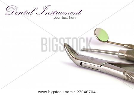 Dental tools and equipment on white background.