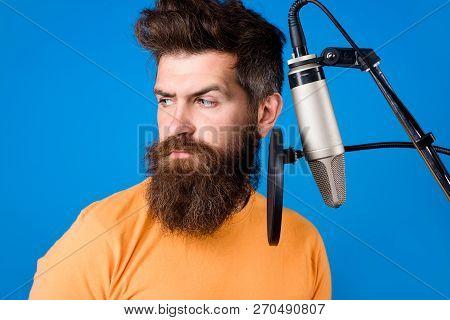 Male Lead Vocalist Singing In Recording Studio. Vocalist Singing In Condenser Microphone. Concert&mu