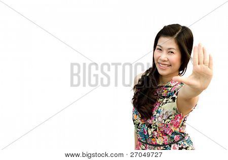 Portrait of a cute young female gesturing a stop sign isolated over white (focus on face)