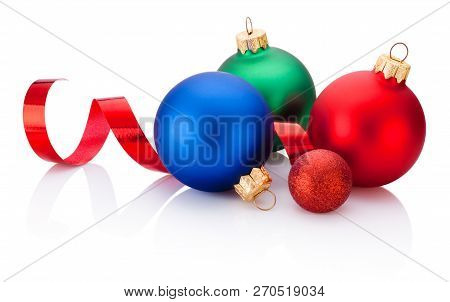 Christmas Colored Baubles And Curling Paper Isolated On White Background