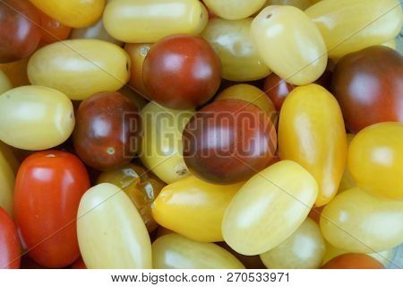 Red Tomatoes On A Wooden Background Filling The Frame.