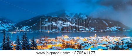 Panoramic View Of Zell Am See With Zeller See Lake In Twilight During Blue Hour At Dusk In Winter, S
