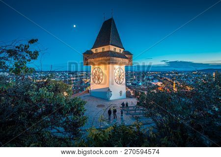 Beautiful Twilight View Of Famous Grazer Uhrturm (clock Tower) Illuminated During Blue Hour At Dusk,