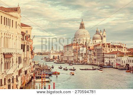 Classic Panoramic View Of Famous Canal Grande With Scenic Basilica Di Santa Maria Della Salute In Be