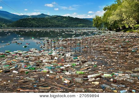 tons of plastic bottles and other waste floating on beautiful lake