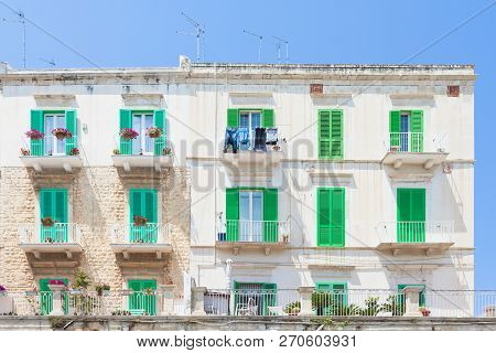 Molfetta, Apulia, Italy - Green Window Shutters At The Historical Facades In Molfetta