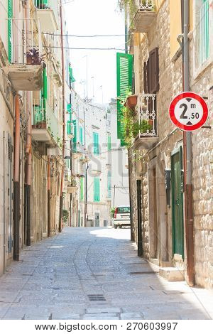 Molfetta, Apulia, Italy - Walking Through An Old Alleyway In Molfetta