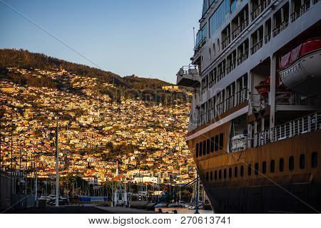 Funchal, Madeira - 2018. Cruise Ship Docked In The Main Harbor At Sunset. View. Over The City.