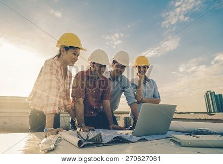Happy Professional Construction Engineers Working With Corporate Colleagues Teamwork And Equipment S