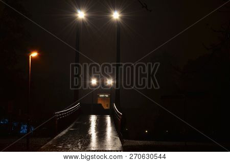 Night View Of The Footbridge Over The Vltava River In Ceske Budejovice Near The Budvar Arena On The