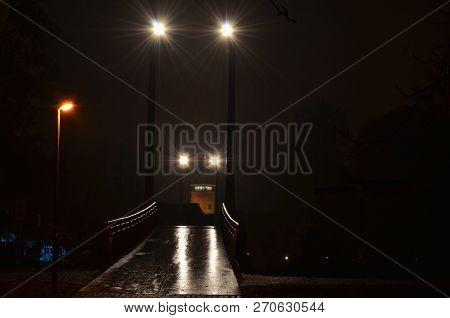 Night View Of The Footbridge Over The Vltava River In Ceske Budejovice Near The Budvar Arena On The