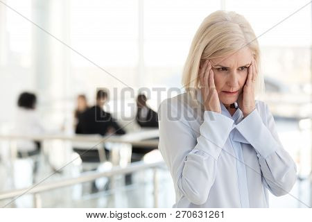 Stressed Fatigued Mature Businesswoman Suffer From Headache In O