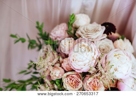 Wedding Flowers, Bridal Bouquet Closeup. Decoration Made Of Roses, Peonies And Decorative Plants, Cl