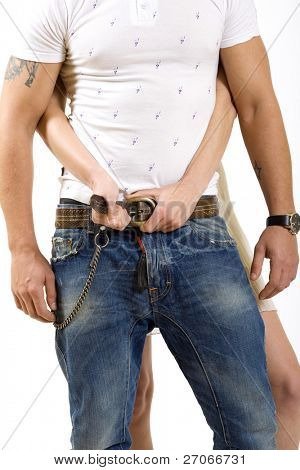 picture of a woman unbuckle  man's belt