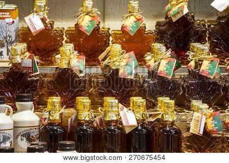 Montreal, Canada - November 3, 2018: Maple Syrup Bottles For Sale On Montreal Jean Talon Market. Que