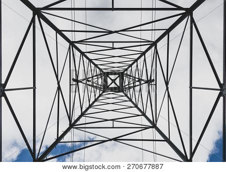 Steel Electricity Transmission Line Power Tower Abstract With Clouds