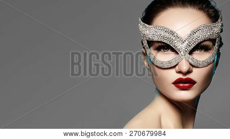 Beautiful Model With Fashion Lips Makeup Wearing Bright Brilliant Mask. Masquerade Style Woman. Holi