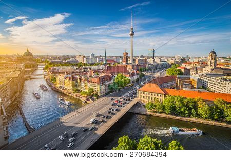 Aerial View Of Berlin Skyline With Famous Tv Tower And Spree River In Beautiful Evening Light At Sun