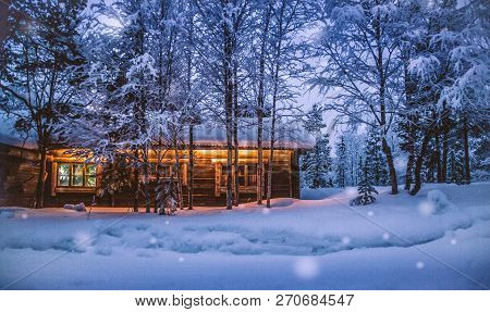Romantic View Of Old Traditional Wooden Forest Cabin In The Woods Embedded In Scenic Northern Winter