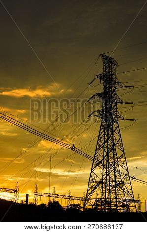 High Voltage Post High-voltage Tower / Silhouette Of High Voltage Post On Sunset Orange Yellow Sky B