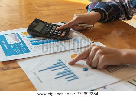 Woman Working With Calculator For Calculating Numbers.expenses Calculator,loan Investment Documents.