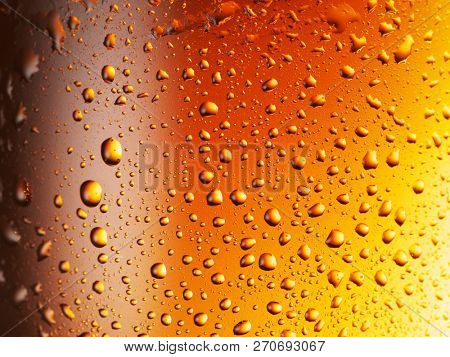 Condensated drops of misted glass of beer. Close up shot .