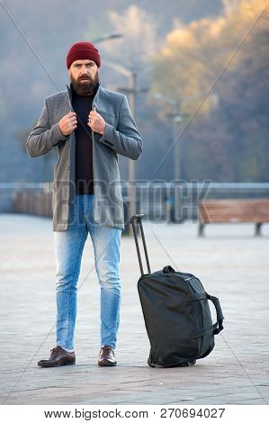 Man Bearded Hipster Travel With Big Luggage Bag Wait For Taxi Bring Him To Hotel. Travel Tips. Trave