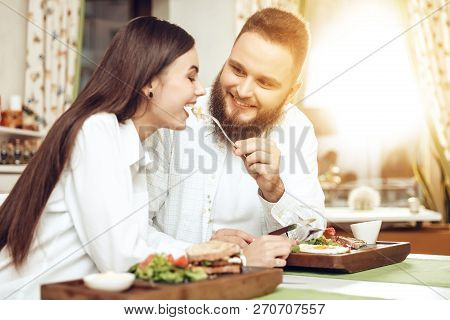 Romantic Dinner Happy Men And Women In Restaurant. Happy Couple Enjoying A Romantic Dinner In Two. A