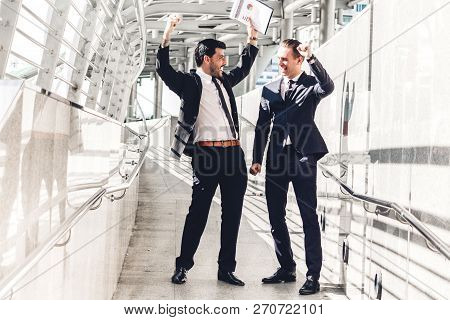 Successful Of Two Businessman In Black Elegant Suit Celebrating With Arms Up And Working Together On