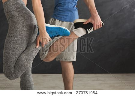 Couple Warming Up Legs Before Training At Gym. Unrecognizable Man And Woman Doing Stretching Exercis