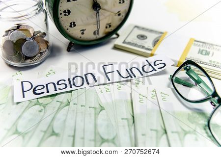 Retirement Fund Concept - Money And A Calculator