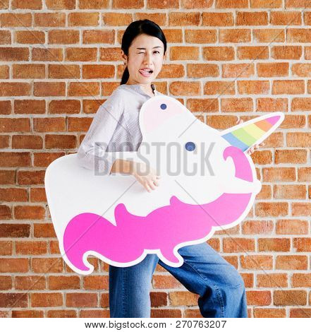 Goofy faced woman with a unicorn