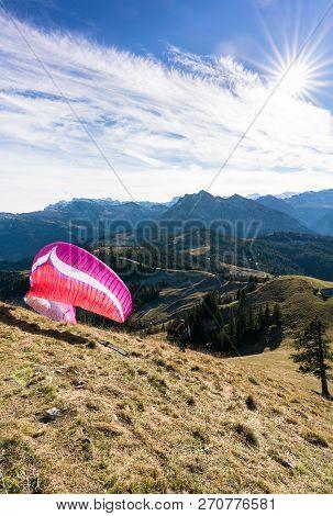 Einsiedeln, Sz / Switzerland - November 25, 2018: Man With Paraglider Preparing For Take Off From A