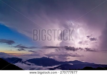 Storm In The Mountains. Storm Clouds Over Snow-capped Mountains.