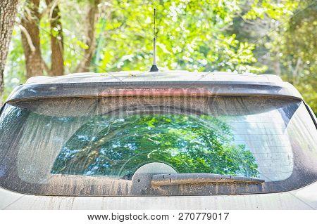 Rear Car Wiper With Dirty Dust On Rear Car Windows