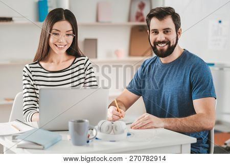 Two Young Self-employed Personalities Working From Home