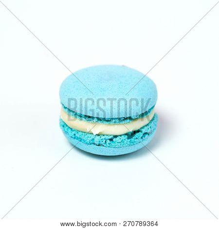 Sweet blue macaroon isolated on white background.