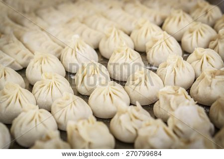 Raw Chinese Dumplings On Table, Closeup, Selected Focus. Dumplings Are Among The Most Typical Food I