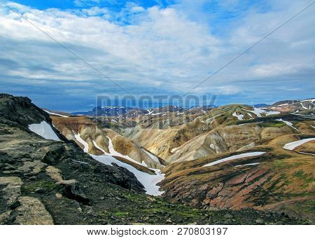 Panoramic view on Jokultungur geothermal area. Colorful rhyolite mountains with bright yellow, orange, brown stone under snow, Laugavegur route, Fjallabak Nature Reserve, Highlands of Iceland, Europe poster