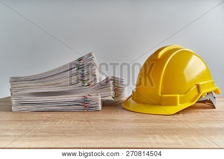 Stack Overload Document Of Report With Yellow Engineer Hat