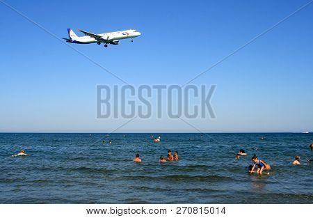 Larnaca, Cyprus, June 25th, 2017: An Airplane Passing Over The Mackenzie Beach To Approach Larnaca I